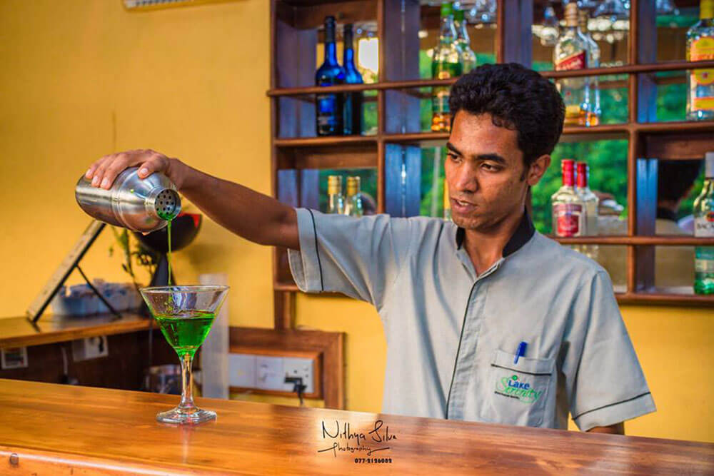 Hotel Bartender pouring a wine